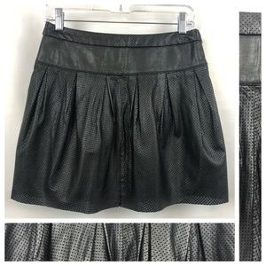 Perforated pleated leather skirt with silk lining